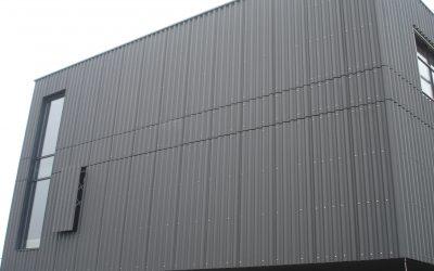 Corrugated fibre-cement facades
